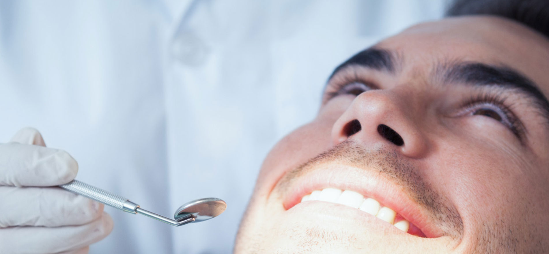 Man smiling at the dental